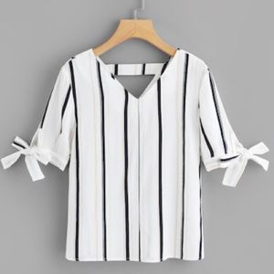 Striped shirt with bow sleeves